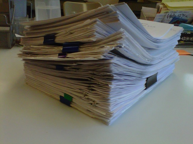 "This was the stack by the time I left school this afternoon.  And no need to tell me I should ""assign less work.""  Most of these are essay revisions and final-exam writing projects."