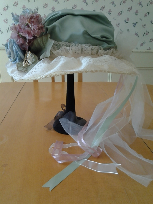 From this side angle, you can see the long ribbon and tulle train.