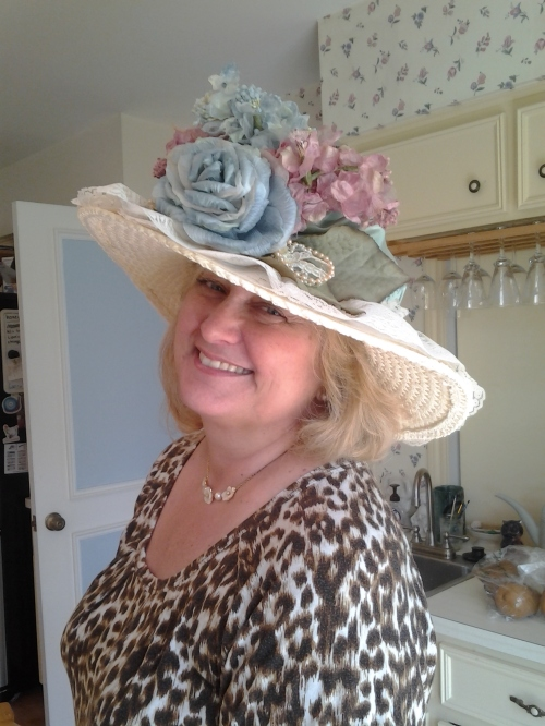 My lovely friend Elani graciously agreed to model the hat for me when she came over today to help me roll grapeleaves (Lebanese style) for Easter.