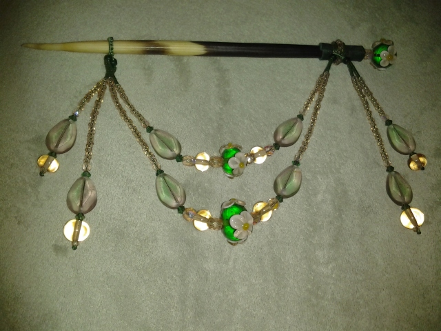 This adornment was made by Saorsa Studio of Beads.